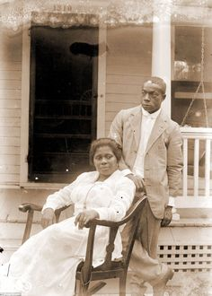 From 1910-1925 amateur photographer John Johnson (right) took hundreds of photographs of the African American and immigrant communities in Lincoln, Nebraska. Johnson married Odessa Price (left) on August 20, 1918. She was 27 and he was 39. This is believed to be their wedding portrait.