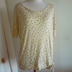 "Anthropologie Deletta ivory floral print top Very comfortable lightweight modal fabric. In great condition. Small prints of blue bonnets. Wide neck and tie knot detail. Measurements laying flat are: bust 24"", length from back 23"". Fabric is a little thin and slightly see through. Anthropologie Tops"