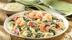 This Creamy Shrimp Alfredo recipe is perfectly yummy and easy! Prepare Knorr® Pasta Sides™ - Alfredo according to package directions, stirring in tomatoes and spinach during the last 5 minutes of cook time. Cook shrimp until pink and add to hot pasta. Sprinkle freshly grated parmesan cheese to finish! Add this to your dinner recipes!