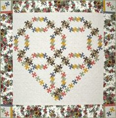 "RGR153 - Wedding Ring Heart Twist - Small Wall Hanging 33"" Sq, / Large Wall Hanging 56 1/4"" Sq. / Quilt 95"" Sq."