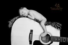 I MUST do this when I have a baby with Holt's guitar. I am in love with this idea!