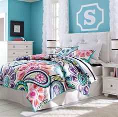 I love the bedding it would go good with Genavive's color scheme of her room.