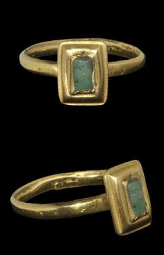 Medieval Gold Ring with Emerald    13th-15th century AD . A finger ring with a plain gold hoop, rectangular bezel with raised collar and central emerald cloison; the hoop possibly of slightly later date.