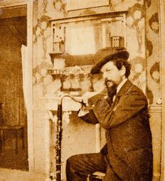 Claude Debussy leaning on his bass clarinet in Pierre Louÿs' home, Paris, 1894 -by Pierre Louÿs