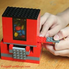 Lego Candy Dispenser - what a fun idea! If only I wasn't completely hopeless when it comes to building things with Legos.
