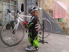 Cycling future |  Yes!  Let them smile and grow into them.  I love this picture! My son's been wearing my jersey's since he was this tall. 12 yrs old now...he wears my older Canari Cycling Jersey's
