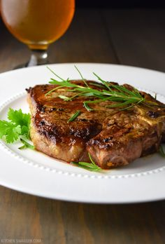 Pan-Seared T-Bone Steak Recipe with Garlic, Butter, and Fresh Rosemary.