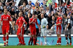 Referee Martin Atkinson shows a red card to Pepe Reina of Liverpool during the Barclays Premier...