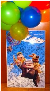 """Laura and Brian's Favorite movie is """"UP"""".  David loves this movie too! The idea was to create something really special for the bride and groom. There was an original high gloss 24″ x 36″ movie poster on Amazon. The poster was foam core mounted, all the guests were able to sign it! Check out more of our videos on our website: www.drsmusic.com #ChicagoWeddingBand #WeddingMusic"""