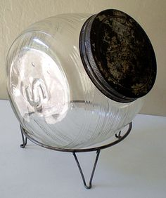 This is a sellers sugar jar for a Sellers kitchen cabinet, The wire rack it's sitting on is for a round sugar jar, not this Sellers jar. Previous pinner stated otherwise - General Store Candy Jar Counter Display Stand Store Counter, Counter Display, Old School Candy, Old General Stores, Catering, Cure, Farm Store, Craft Stalls, Glass Canisters