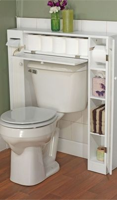 Store toilet paper hidden in a custom cabinet over the toilet! Saves space in the vanity!