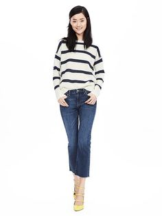 We've added a touch of fringe for a trendy update on this classic navy and cream striped sheer sweater. Style with slim black pants and heeled boots for a laid back winter look   Banana Republic