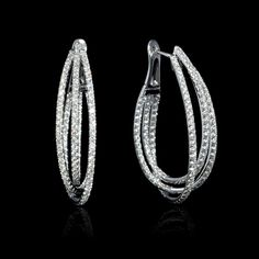 This stylish pair of 18k white gold hoop earrings, feature 276 round brilliant cut white diamonds of F color, VS2 clarity and excellent cut and brilliance, weighing 3.88 carats total.