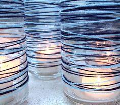 Yarn wrapped vase candle holders