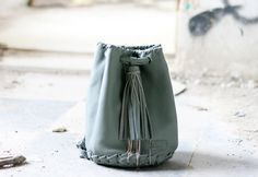 Leather Grey Bag - Bucket bag with Long Tassel and Silver Metalic Chain - Pouch - Backpack - Crossbody - Shoulder Bag - Drawstring Pouch by EleannaKatsira on Etsy Leather Bags Handmade, Handmade Bags, Drawstring Pouch, Crossbody Shoulder Bag, Grey Leather, Italian Leather, Bucket Bag, Tassels, Purses