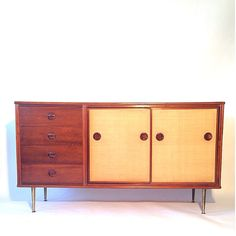William Watting; Nutwood, Grass-Cloth and Brass Sideboard for Fristho Kraneker, 1950s.