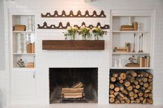 Architectural pieces, books, candlesticks, flowers and rustic wood - this speaks to my soul