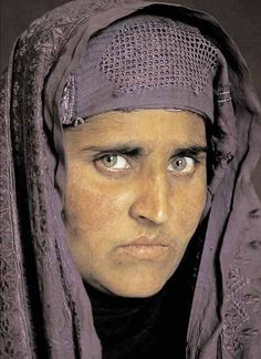 15 years later.... National Geographic photographer Steve McCurry was in the Afghanistan-Pakistan border region and found  Sharbat Gula where he photographed her once again.  PHOTO 2