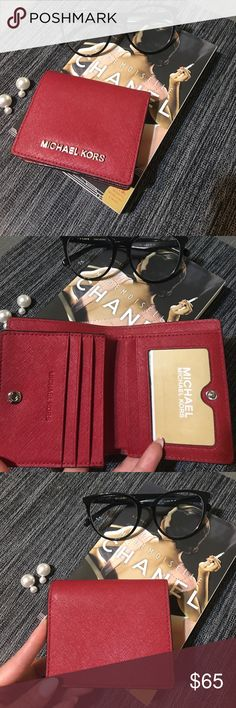 Michael Korda Wallet Deep red excellent condition wallet. 7 card slots, 1 bill slot used once or twice and been sitting in my closet for too long. This baby needs a new home. Michael Kors Bags Wallets