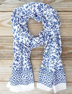 Bright Blue Abstract Scarf  A light-weight and ethically made cotton scarf in an abstract blue and white hand block print that makes us think of a Jackson Pollock painting.  Details:  Hand block stamped with eco dyes 100% fair-trade Fair trade & made in India