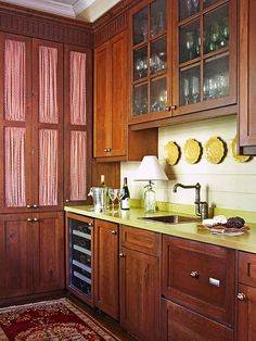 Designed by Atlanta interior designer June Price. Cabinet doors with wire fronts were backed with shirred fabric for a French country style in the butler's pantry.