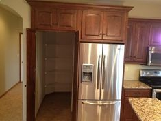 Walk-in pantry behind the fridge!! THIS is going to be in my house one day.