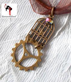 Colgante con jaula de pájaro y engranaje en bronce. de kanzashilandShop en Etsy