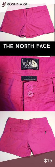 """NORTH FACE Shorts Abrielle cuffed legs ripstop 8 The North Face is known worldwide for high quality clothing, these shorts are no exception. 5 pockets, back pockets feature button closure. Double button waist, 2.5"""" zipper, 9"""" rise, 5"""" inseam. Cuffed legs have button stays. Ripstop durable but lightweight 97 cotton, 3 elastase for plenty of stretch & a comfortable flattering fit. 2 extra buttons attached to tag inside. Fuschia shade of pink. Machine wash. In great condition for a reasonable…"""