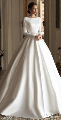 Simple princess ball gown wedding dress with bateau neckline and long sleeves for the romantic modest bride | Luce Sposa 2021 Wedding Dresses | Sorrento, Italy Campaign - SANTA - Belle The Magazine #weddingdress #weddingdresses #bridalgown #bridal #bridalgowns #weddinggown #bridetobe #weddings #bride #dreamdress #bridalcollection #bridaldress #dress See more gorgeous bridal gowns by clicking on the photo Modest Wedding Dresses With Sleeves, Princess Wedding Dresses, Elegant Wedding Dress, Dream Wedding Dresses, Bridal Dresses, Gown Wedding, Princess Bride Dress, Wedding Dresses With Flowers, Tulle Wedding