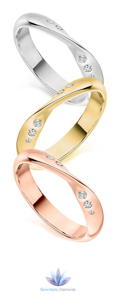 The ribbon twist diamond wedding ring featuring graduated flush set diamonds across a 3.6mm wide band. Available in 950 Platinum, 950 Palladium and three colours of 18ct Gold. A comfortable twisted band with precision flush set diamonds (0.09cts F VS1) Available at Serendipity Diamonds.
