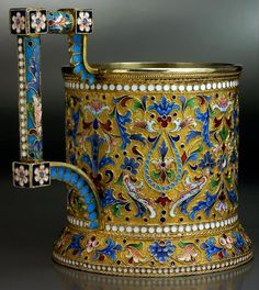 An antique Russian gilded silver and shaded cloisonne enamel tea glass holder by Ivan Saltykov, Moscow, circa 1890