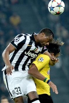 Juventus' Patrice Evra challenges the ball with Borussia Dortmund Pierre Emerick Aubameyang during the Champions League round of 16 first leg soccer match between Juventus and Borussia Dortmund at the Juventus Stadium, in Turin, Italy, Tuesday, Feb. 24, 2015.
