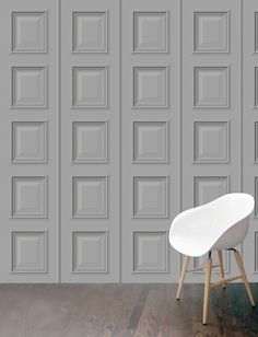 'Benjamin' mini panelling wallpaper in light grey featuring a repeating wooden panel. Perfect for smaller rooms this mini panelling sports a repeating vertical molding.