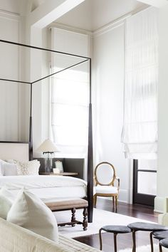 Gorgeous master bedroom with white walls, lots of natural light, four poster bed. Quietly elegant and so sophisticated!