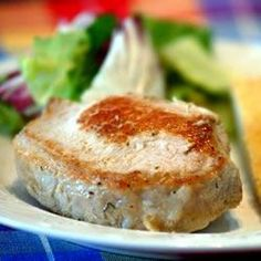 Very easy recipe for tasty pork chops stuffed with bread crumbs, onion, parsley, spices and simmered in a beef broth.