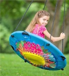 """All Ages Swinging Chair Unusual TOYS Swing Chair Furniture Patio Kids Backyard"" Not too hard to diy with an old mini-trampoline."