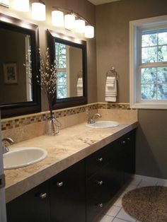 Wall color ; lights above mirrors ; countertop ; cabinets ; etc