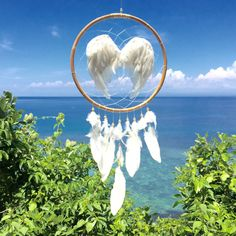 Hello Monday  This is one of the most beautiful dream catchers ever  Extra large #dreamcatcher woven with white Angel Wings on a natural #bamboo whoop  Pure bliss ✨