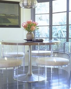 These dining chairs are pretty fabulous don't you agree? Notice how being able to see through them makes such a difference, especially since it looks like there's a fantastic view from those windows?  A solid chair wouldn't have the same effect. A-Z Home Decor Trend 2014: Lucite with Alice T. Chan, San Francisco Bay Area Interior Renovation and Design Specialist