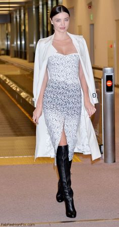Miranda Kerr dressed in trench coat, strapless dress and Louboutin over-the-knee boots while spotted arriving at Narita International Airport in Tokyo (December 2014). #mirandakerr