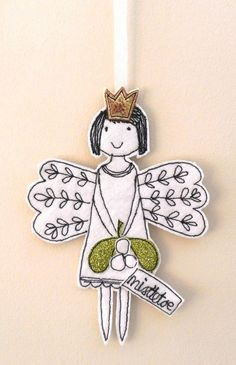 Meet 'Linen Fairy Mistletoe', she wears a golden crown on her head and holds a sprig of glittery mistletoe with a sewn fabric label 'mistletoe'. This little fabric fairy, with her enchanting smile, will complement your Christmas tree or make a unique g. Felt Christmas Decorations, Ribbon On Christmas Tree, Christmas Tree Design, Felt Christmas Ornaments, Noel Christmas, Handmade Christmas, Christmas Projects, Felt Crafts, Christmas Crafts