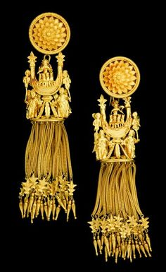 A pair of fine gold tassel revival earrings, Castellani   archeological revivial   Ornate blossom earring with detachable pendants displaying Apollo with his horses over a crescent held on high by two flanking angels, followed by braided fringe tassels ending with amphorae beads.