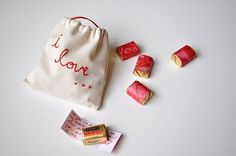 <3 Want to stitch a bag like this with notes wrapped around chocolates for my sweetie telling him how much I <3 him!