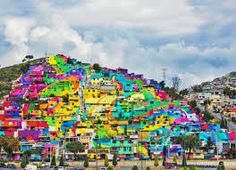 The government of Mexico collaborates with local street artists, Germen Crew, to complete this amazing urban renewal project. 209 homes were painted in Pachuca, Mexico to complete the square meter mural. Banksy, Graffiti Kunst, Graffiti Artists, Painted Hills, Large Scale Art, Rainbow Painting, Mural Painting, Street Artists, Public Art
