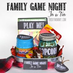 A Gift In A Tin: Family Game Night in a Tin. Ideas on what to include + free printables! A great Christmas or anytime gift. www.thediymommy.com