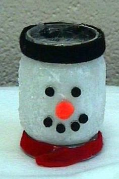Snowman candle holder with baby food jar,white tissue papaer, glitter and craft glue. Small pom-poms for nose, mouth, and eyes. Felt for hat, and Ribbon for the scarf.