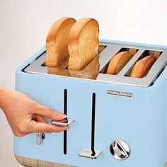 The Azure (blue) Aspect 4-slice toaster with wooden trims has that Scandinavian style of simplicity and elegance, blended together in an efficient appliance.