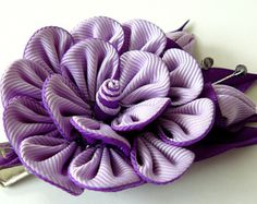 A flower is made in the technique of tsumami kanzashi.    Flower is made from grosgrain ribbons.      At your request can be made in a different color combinations.    My handworks can be a unique gift for you, your family and friends!    For more items, please visit my shop home:  http://www.etsy.com/shop/JuLVa
