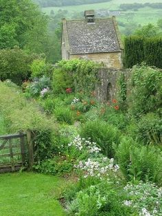 A dream garden with a bonus cottage!  I thought about planting a cottage garden, and it turns out that the laissez faire look is really hard to set up and maintain.  Who knew?