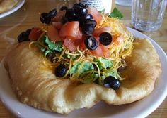 Indian fry bread is tradition to the Navajo. This fried bread is a flat bread typically consisting of flour, water and baking powder which is fried in oil. The versatile doughy delight…
